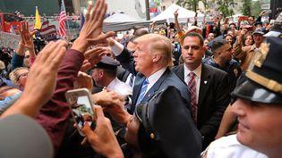 Donald Trump sort de la TYrump Tower, le 8 octobre 2016, à New York. (SPENCER PLATT / GETTY IMAGES NORTH AMERICA / AFP)
