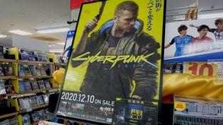 La sortie du jeu vidéo Cyberpunk 2077 à Tokyo (Japon) le 18 décembre 2020 (KAZUHIRO NOGI / AFP)