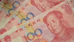 La Chine a de nouveau dévalué sa monnaie, mercredi 12 août. (PETER PARKS / AFP)