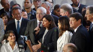 Anne Hidalgo annonce officiellement la candidature de Paris pour l'organisation des JO en 2024, le 23 juin 2015, à Paris. (FRANCOIS GUILLOT / AFP)
