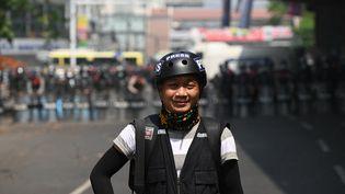 Le photographe de l'agence AP Thein Zaw, lors d'une manifestation à Rangoun, en Birmanie, le 26 février 2021. (AFP)