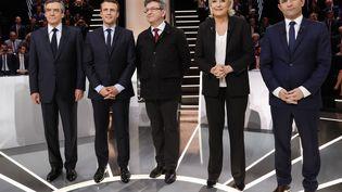 """François Fillon, Emmanuel Macron, Jean-Luc Mélenchon, Marine Le Pen et Benoît Hamon lors du """"Grand débat"""" de BFM TV et CNews, à Aubervilliers (Seine-Saint-Denis), le 20 mars 2017. (PATRICK KOVARIK / AFP)"""