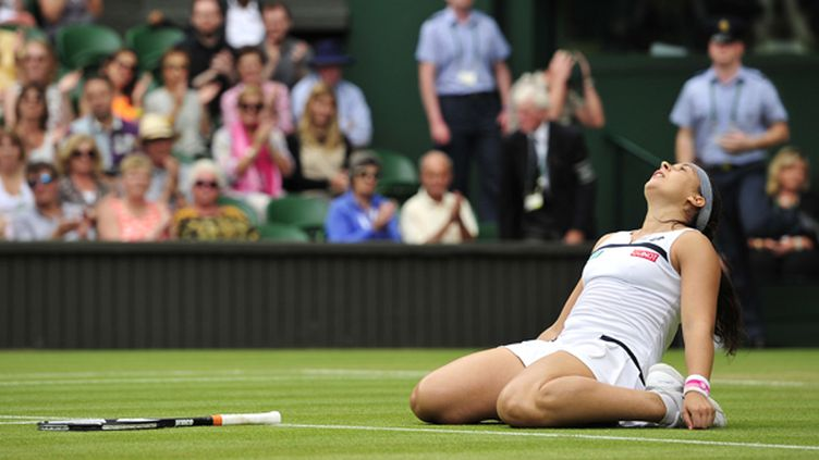 Bartoli sur la pelouse londonienne (GLYN KIRK / AFP)
