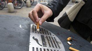 Photo d'illustration :Un million de Français qui fumaient chaque jour ont arrêté en l'espace d'un an, a annoncé le 28 mai 2018 le ministère de la Santé. (MAXPPP)