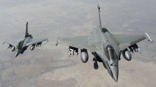 Deux avions de chasse Rafale français survolent l'Irak pour une mission de reconnaissance, le 15 septembre 2014. (BRUNET/ECPAD/SIPA)