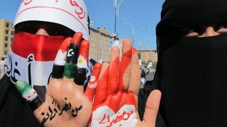 Sanaa, le 27 janvier 2012: ces femmes demandent l'arrestation et la comparution de l'ancien président Yéménite, Ali Abdullah Saleh. (AFP PHOTO/JAMAL NOMAN)