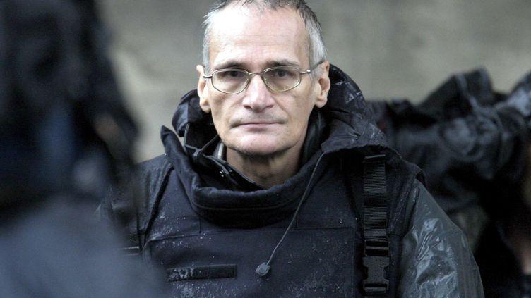 Francis Heaulme, lors de la reconstitution du double meurtre à Montigny-lès-Metz (Moselle), le 3 octobre 2006. (MAXPPP)