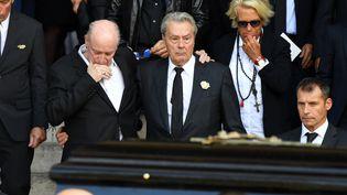 Le mari de Mireille Darc, Pascal Desprez (gauche) et Alain Delon (ERIC FEFERBERG / AFP)