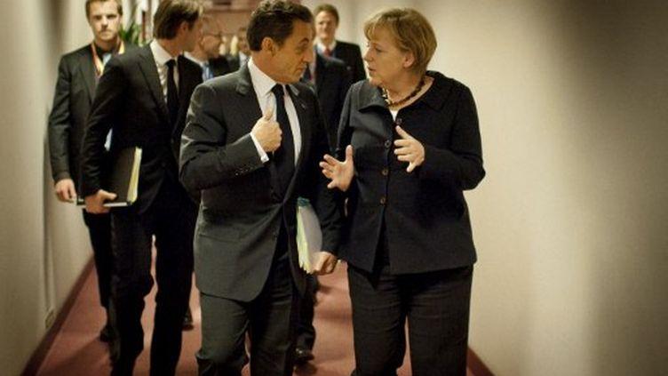 Nicolas Sarkozy et Angela Merkel à Bruxelles, le 22 octobre 2011. (JESCO DENZEL / BUNDESREGEIRUNG / AFP)