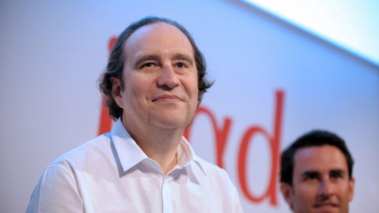 Xavier Niel, le fondateur d'Iliad (à g.)et le directeur financier du groupe, Thomas Reynaud, le 8 mars 2012. (ERIC PIERMONT / AFP)