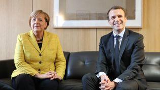 Angela Merkel et Emmanuel Macron, lors d'un sommet européen à Bruxelles (Belgique), le 14 décembre 2017. (LUDOVIC MARIN / AFP)