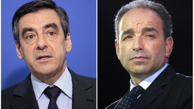 François Fillon etJean-François Copé, tous deux candidats à la présidence de l'UMP, détiendraient respectivement 46 103 et environ 47 000 parrainages, samedi 22 septembre 2012. (JACQUES DEMARTHON / AFP)