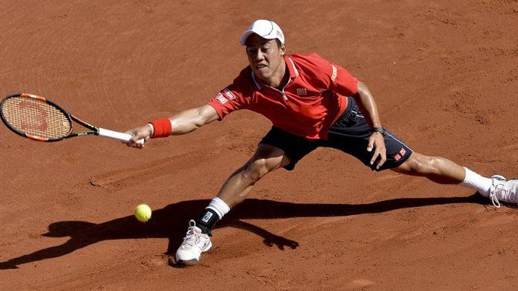 Kei Nishikori continue l'aventure sur la terre battue espagnole (JOSEP LAGO / AFP)