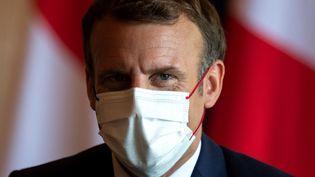 Emmanuel Macron, à Tokyo, le 24 juillet 2021. (CHARLY TRIBALLEAU / AFP)