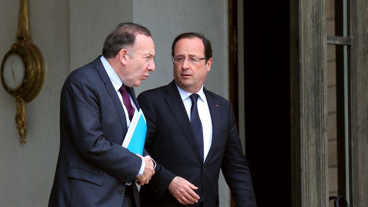 Le président du Medef, Pierre Gattaz, et François Hollande, le 4 juillet 2013. (THOMAS SAMSON / AFP)