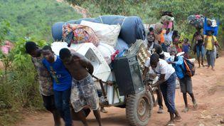 Migrants congolas expulsés d'Angola près de la ville de Kamako (RDC), le 12 octobre 2018. (SOSTHENE KAMBIDI / AFP)