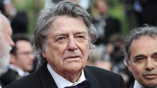 Le cinéaste Jean-Pierre Mocky à la cérémonie d'ouverture du Festival de Cannes, le 12 mai 2010. (ANNE-CHRISTINE POUJOULAT / AFP)