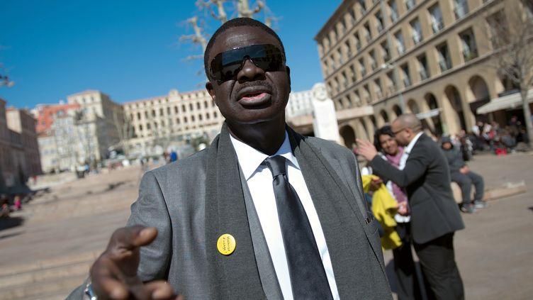 L'ancien président de l'OM Pape Diouf, candidat à la mairie de Marseille (Bouches-du-Rhône), le 7 mars 2014. (BERTRAND LANGLOIS / AFP)