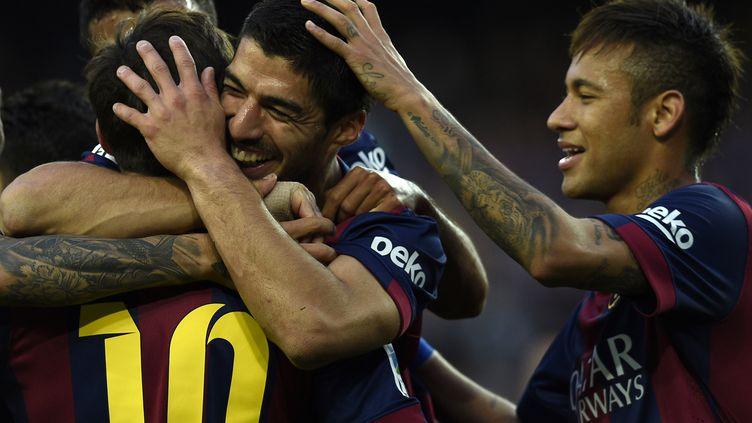 Lionel Messi, Luis Suarez et Neymar ont tous marqué lors de la large victoire du Barça face à Getafe. (LLUIS GENE / AFP)