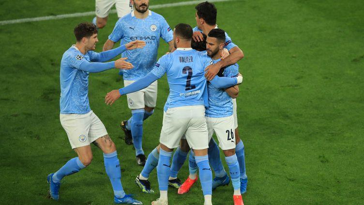 Manchester City célèbre contre Dortmund  (WOLFGANG RATTAY / AFP)