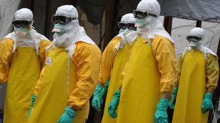 Des volontaires de Médecins sans frontières, à Monrovia, au Liberia, le 30 aout 2014. (DOMINIQUE FAGET / AFP)