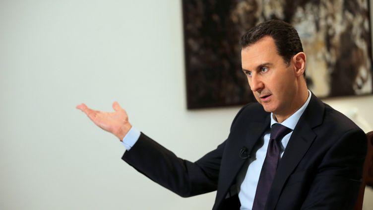 Le président syrien Bachar Al-Assad, ici en février 2016, s'est exprimé auprès de trois médias français dont franceinfo, sur le futur de la Syrie lors de la conférence de paix prévue à Astana, fin janvier. (JOSEPH EID / AFP)