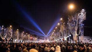 Nuit du nouvel an sur les Champs Elysées, le 31 décembre 2014. (DANIEL HAUG / MOMENT RM / GETTY IMAGES)