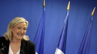 La présidente du Front national, Marine Le Pen, commente les résultats du FN aux élections départementales,le 22 mars 2015, à Nanterre (Hauts-de-Seine). (KENZO TRIBOUILLARD / AFP)