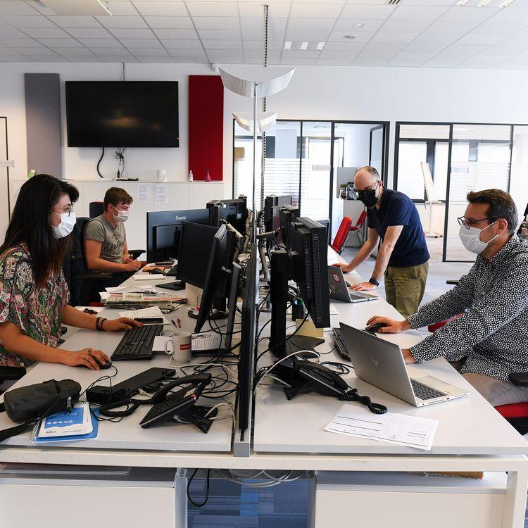 Le retour des salariés sur leur lieu de travail est soumisau respect desrègles sanitaires en vigueur. (JOSSELIN CLAIR / MAXPPP)