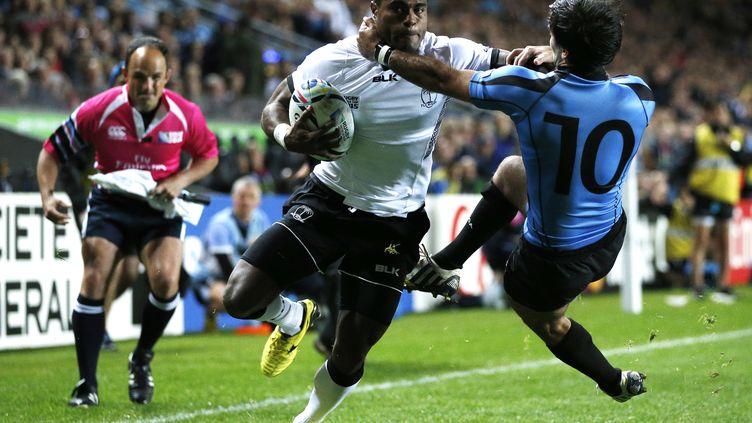 Kenatale s'apprête à marquer en coin face à l'Uruguay (ADRIAN DENNIS / AFP)