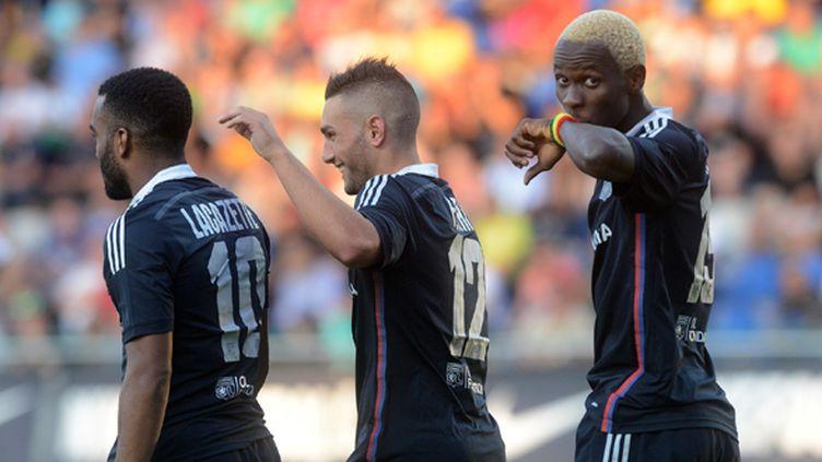 La joie des Lyonnais Lacazette, Ferri et Yattara (MICHAL CIZEK / AFP)