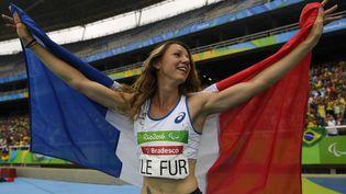 L'athlète Marie-Amélie Le Fur, lors de son sacre en saut en longueur, aux Jeux paralympiques de Rio, le 9 septembre 2016. (CHRISTOPHE SIMON / AFP)