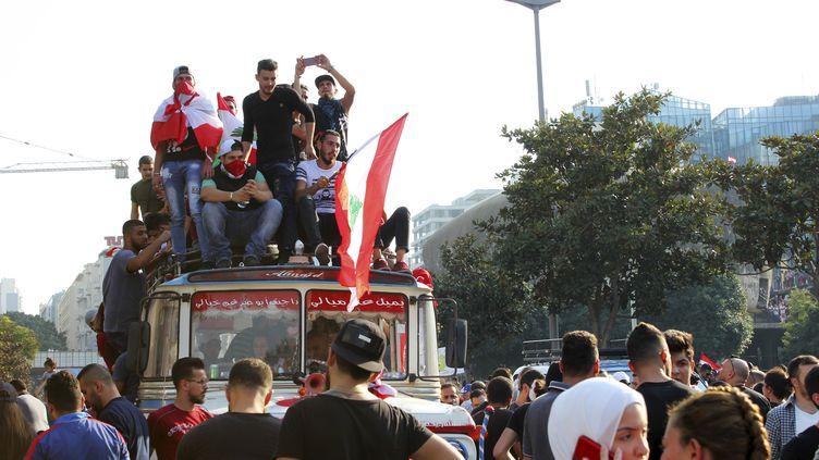 Des manifestants dans les rues deBeyrouth (Liban), le 20 octobre 2019. (FATIMA ABDULLAH / APA IMAGES VIA ZUMA WIRE / REA)
