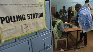 Les Kényans ont commencé à voter mardi matin pour des élections générales âprement disputées. (SIMON MAINA / STR)