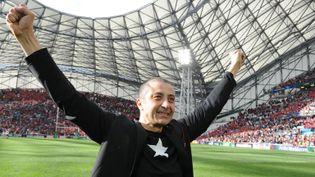 Mourad Boudjellal au stade Vélodrome de Marseille, après la victoire de Toulon en demi-finale de Coupe d'Europe de rugby face au Munster, le 27 avril 2014. (BORIS HORVAT / AFP)