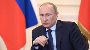 Vladimir Poutine, le 4 mars 2014, lors d'une conférence de presse àNovo-Ogaryovo (Russie). (ALEKSEY NIKOLSKYI / RIA NOVOSTI / AFP)