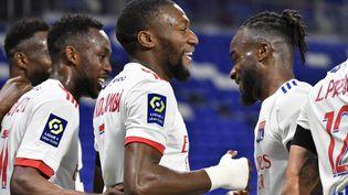 Les joueurs de l'Olympique lyonnais, dimanche 25 octobre 2020 face à Monaco. (PHILIPPE DESMAZES / AFP)