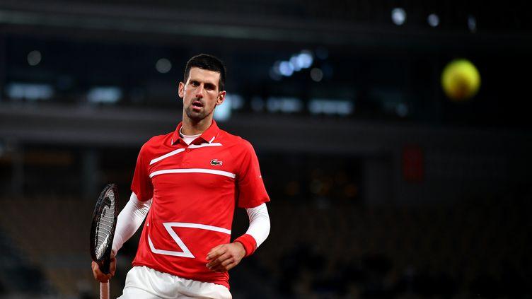 Novak Djokovic, le 5 octobre, face à Karen Khachanov. (ANNE-CHRISTINE POUJOULAT / AFP)
