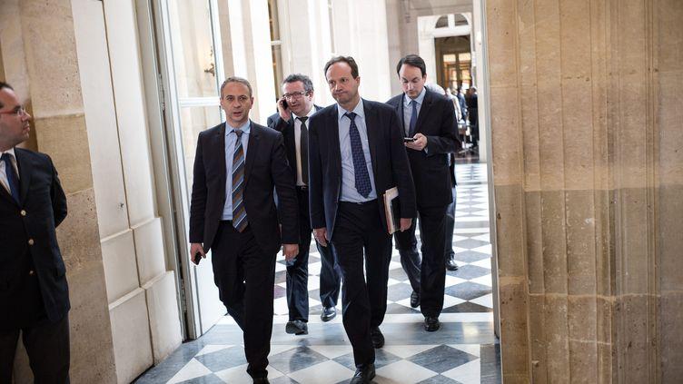 De gauche à droite, les députés PS Laurent Baumel, Christian Paul et Jean-Marc Germain, à l'Assemblée nationale, le 4 juin 2014. (  MAXPPP)