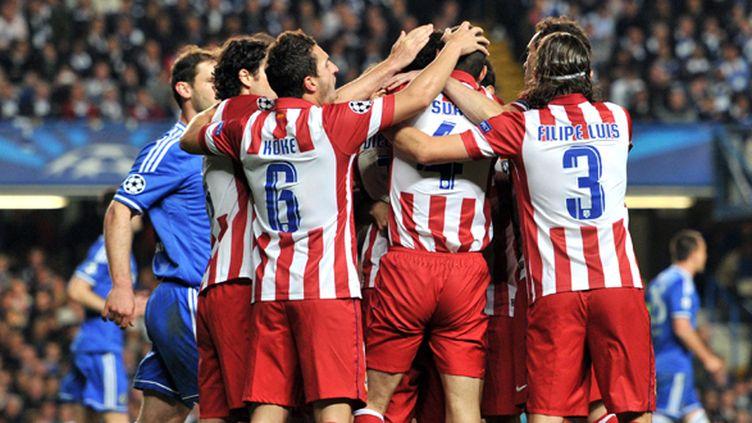La joie de l'Atlético Madrid sur la pelouse de Chelsea (GLYN KIRK / AFP)