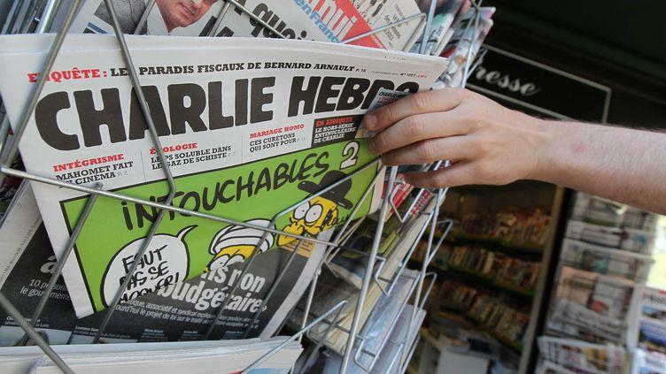 """Le journal satirique """"Charlie Hebdo"""" est au centre d'une polémique après la publication de caricatures de Mahomet, le 19 septembre 2012. (G. VARELA / SIPA)"""