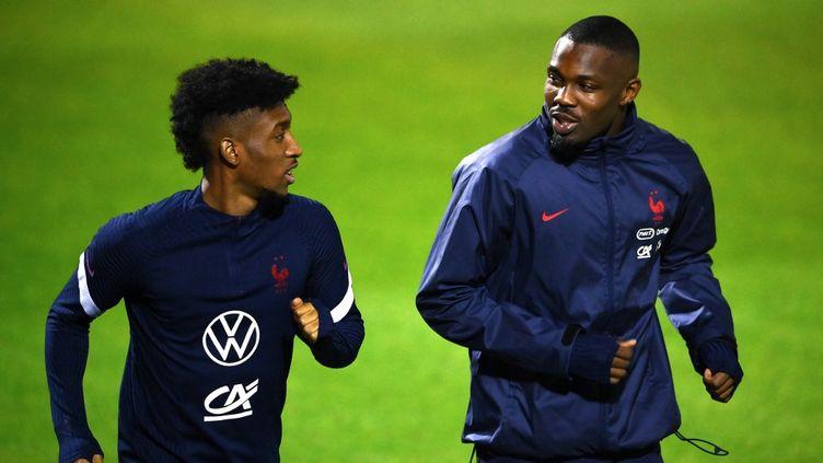 Marcus Thuram (à droite) et Kingsley Coman à l'entraînement avec les Bleus. (FRANCK FIFE / POOL)