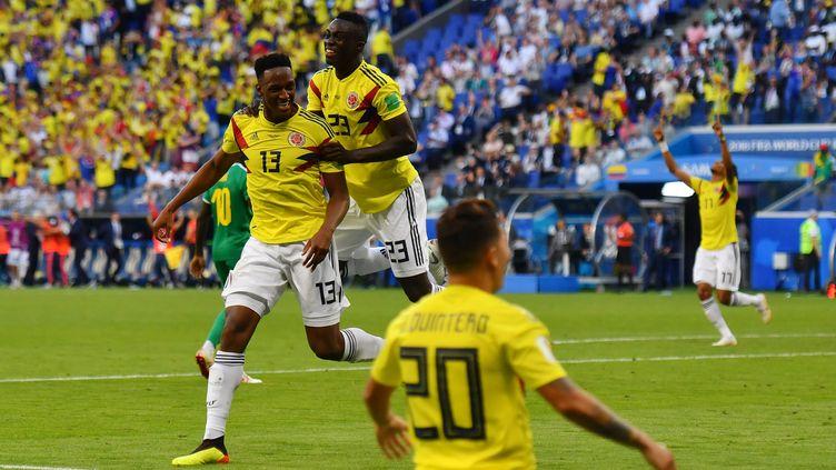 Les joueurs colombiens célèbrent leur victoire après un but marqué contre le Sénégal, le 28 juin 2018, à Samara,en Russie. (MANAN VATSYAYANA / AFP)