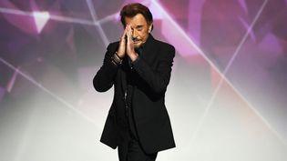 Johnny Hallyday lors des 31e Victoires de la musique, le 12 février 2016 au Zénith de Paris.   (BERTRAND GUAY / AFP)