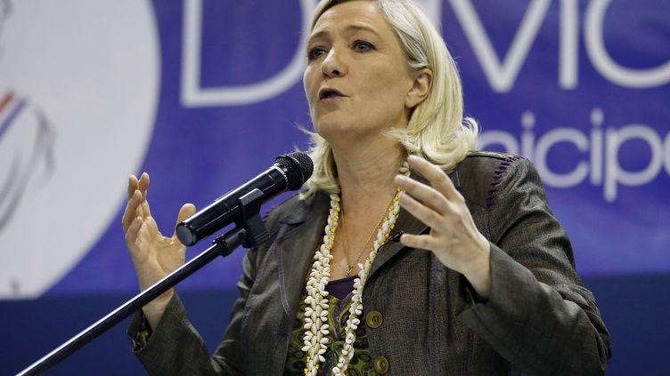 62% des sympathisants FN se déclarent favorables à des accords avec l'UMP lors des élections locales,selon un sondage Ifop pour Atlantico diffusé le 24 mars 2014. (VALERY HACHE / AFP)