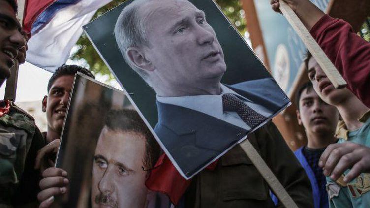 Manifestation de soutien à Vladimir Poutine àLattaquié (Syrie) en 2013. (ANDREY STENIN / RIA NOVOSTI/AFP)