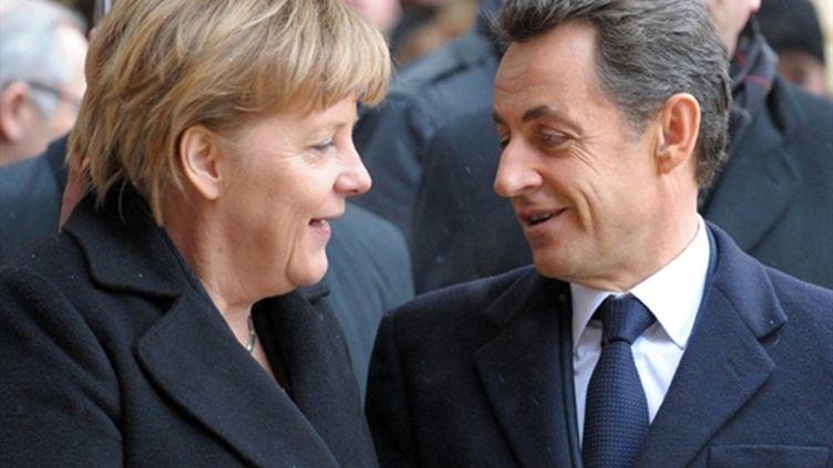 La chancelière Angela Merkel et le président Nicolas Sarkozy au sommet franco-allemand de Fribourg, le 10 décembre 2010 (AFP/FREDERICK FLORIN)
