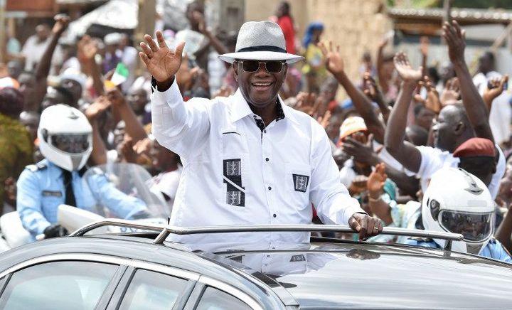 Le président ivoirien Alassane Ouattara en visite dans la ville de Dabou, le 3 août 2015. (Photo AFP/Issouf Sanogo)