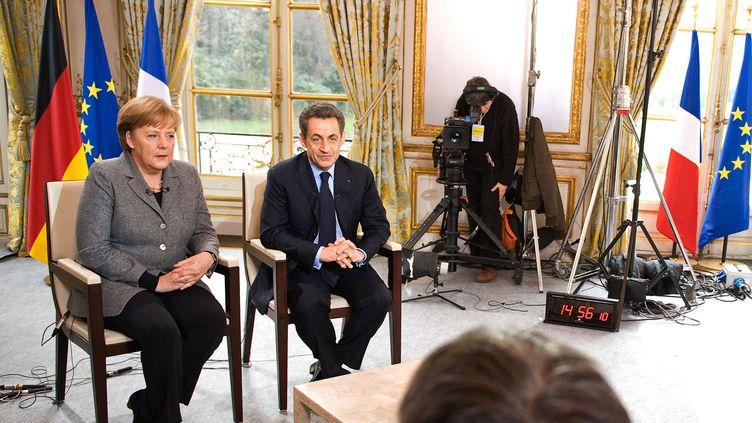 Nicolas Sarkozy et angela Merkel au Palais de l'Elysée (France) le 6 février 2012. (JESCO DENZEL / BUNDESREGIERUNG / AFP)