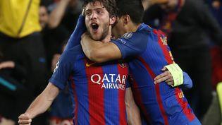 Le Barcelonais Sergi Roberto célèbre son but face au PSG, le 8 mars 2017 au Camp Nou. (PAU BARRENA / AFP)
